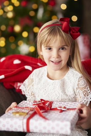 blond girl: Portait of blond girl holding gift Stock Photo