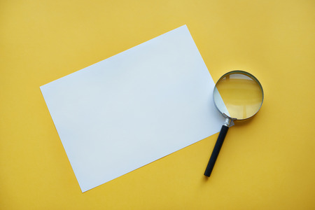 glass paper: Magnifying glass and piece of paper