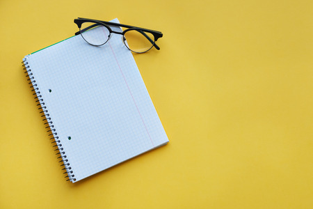 angle view: High angle view of eyewear and notebook