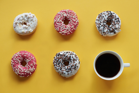 Five donuts with cup of coffee Stock Photo