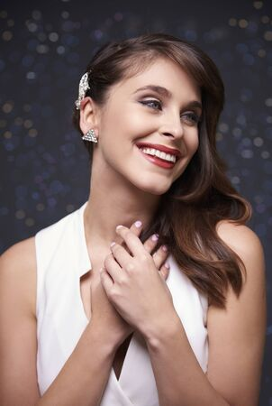 ceremonial make up: Cheerful and elegant woman on sparkle background
