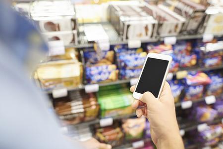 unrecognizable person: The unrecognizable person using phone