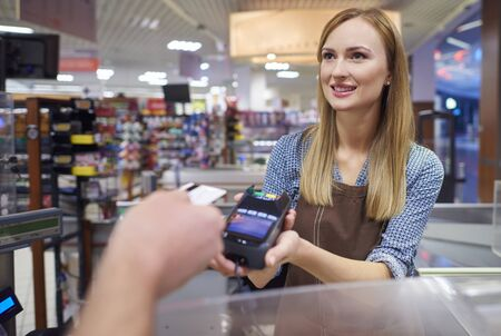 contactless: Woman took a contactless payment