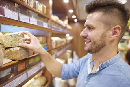side view: Side view of man buying breadstuff Stock Photo