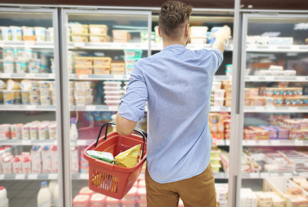 rear view: Quick shopping in local store Stock Photo