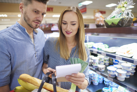shopping list: Couple reading shopping list in supermarket Stock Photo