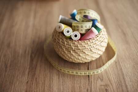Basket with threads and tape measure