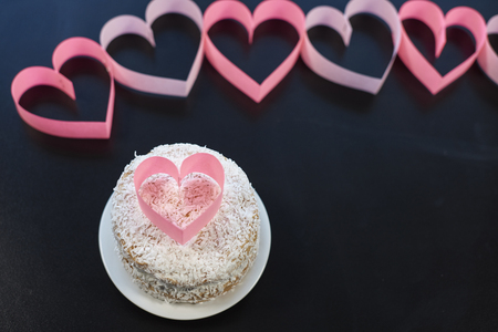 sweet heart: Pink heart on sweet cake Stock Photo