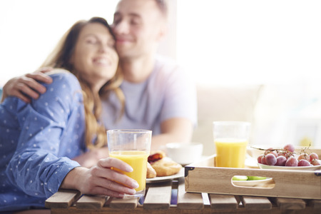 blurred people: Couple enjoying their breakfast meal together