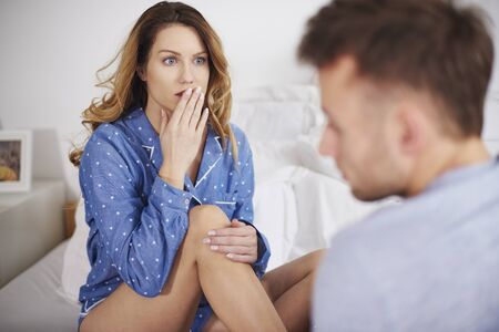 Woman covering mouth in surprise