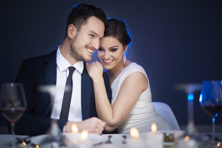 Young couple enjoying romantic meal together