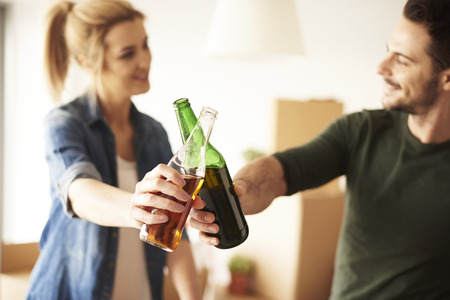 Couple taking a break from unpacking in new flat