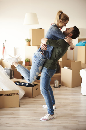 Lucky couple embracing in new house