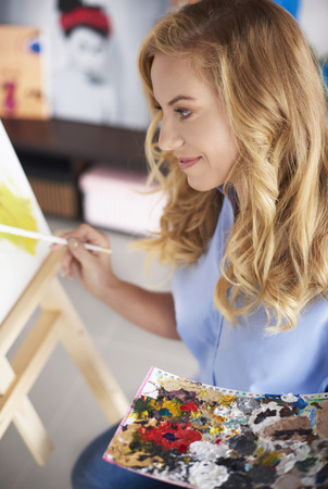 Woman next to the easel  Stock Photo