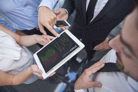 speculating: Business workers speculating about stock market