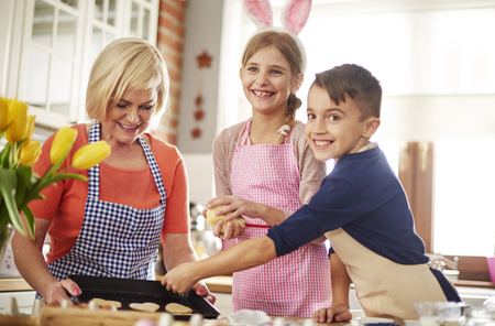 Happy family baking at Easter time