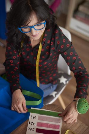 Woman using a fabric pattern board