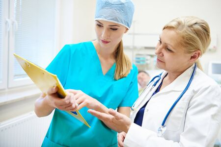 Female doctors discussing some medical records