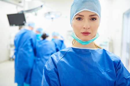 face mask: Portrait of female doctor over operation Stock Photo