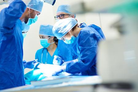 Close up of surgery team operating Foto de archivo