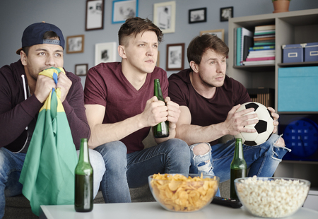 alcohol drinks: Soccer fans in the living room