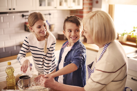 So much fun with grandmother in kitchen