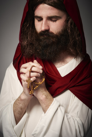 Jesus saying a prayer to the Holy God Stock Photo