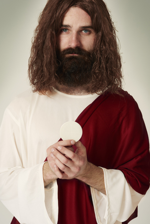 Jesus with the sacred object which is Host Stock Photo