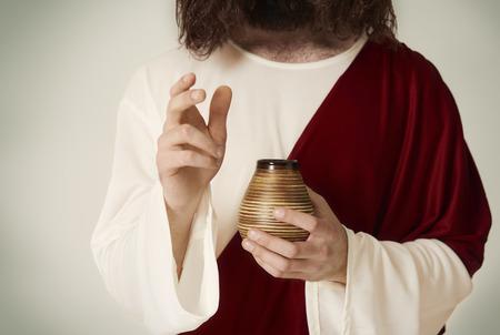 Unrecognizable Saint person with jar