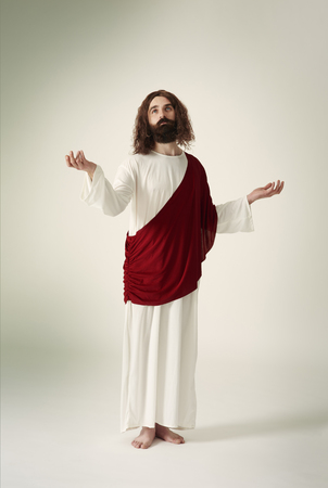 Jesus standing with his hands outstretched Stock Photo