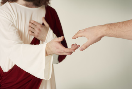 Jesus saving hand reaching for the faithful Stock Photo - 72668274
