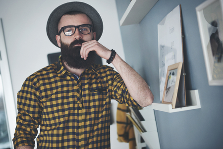 home office: Bearded young man at home office