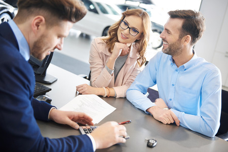 figuring: Salesman figuring the car expense