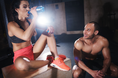 tiredness: Woman and man chatting after gym session Stock Photo