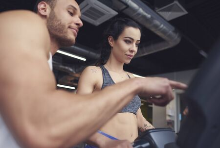 Personal trainer guiding sports woman Stock Photo
