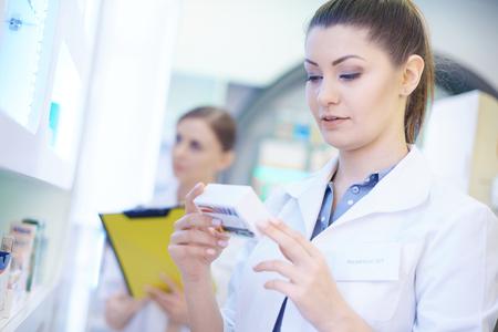 Pharmacist doing checklist at drug store Stock Photo