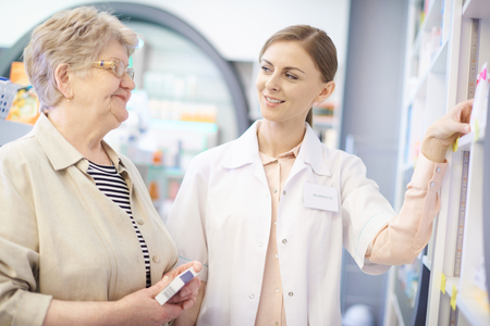 Pharmacist taking care about mature woman health