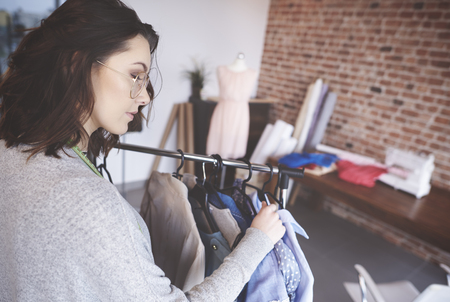 coathanger: Young fashion designer working on new clothes Stock Photo