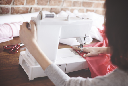 copyspace: Female dressmaker with tailors equipment