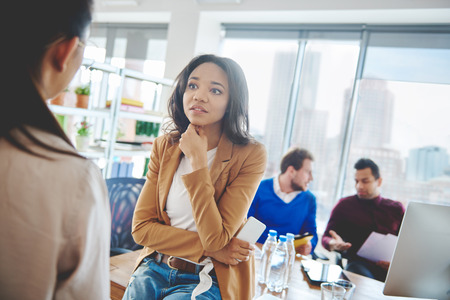Shocked business woman listening to news Stock Photo