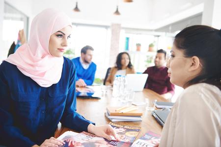 Business women doing documentary work