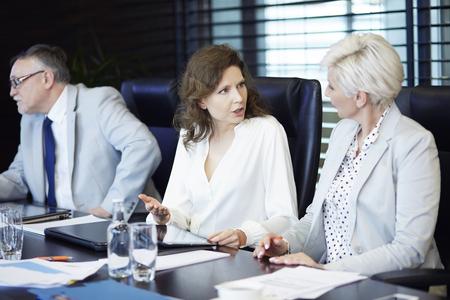 conversating: Business women conversating at work