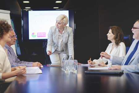 senior adult woman: Senior adult woman leading in conference Stock Photo