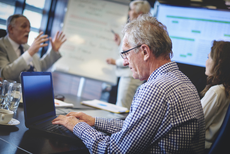 senior adult man: Senior adult business man using laptop
