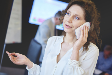 senior adult woman: Senior adult business woman contact by the phone Stock Photo