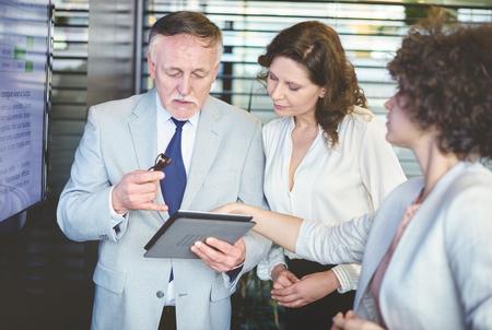businesswear: Senior adult office worker explaining business strategy Stock Photo