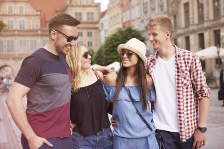 Two couples visiting the city