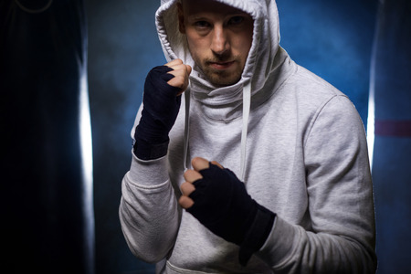 Boxer with hands wraps and hoddie