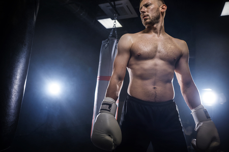 Low angle view of man wearing boxing clothes