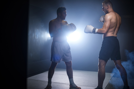 Full length of two fighting boxers